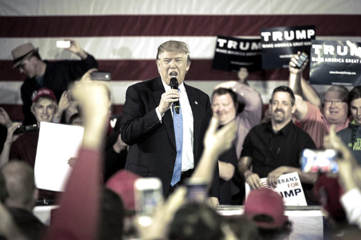 Candidate Donald Trump speaks during a campaign town hall in Janesville, Wis., in March 2016. (Digitally enhanced: Yahoo News; photo: Jabin Botsford/Washington Post via Getty Images)