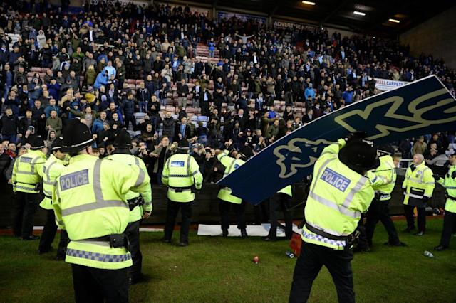 Wigan vs Manchester City FA Cup tie ends in chaos as Sergio Aguero clashes with DW Stadium pitch invaders and away fans row with police