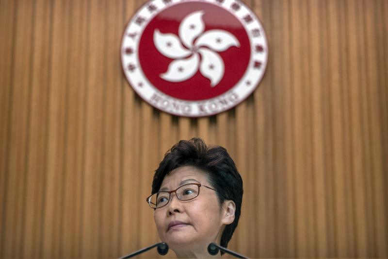 """Hong Kong Chief Executive Carrie Lam listens to a journalist's question during a press conference at the government building in Hong Kong, Tuesday, Oct. 15, 2019. A homemade, remote-controlled bomb intended to """"kill or to harm"""" riot control officers was detonated as they deployed against renewed violence in Hong Kong over the weekend, police said Monday, in a further escalation of destructive street battles gripping the business hub. (AP Photo/Mark Schiefelbein)"""