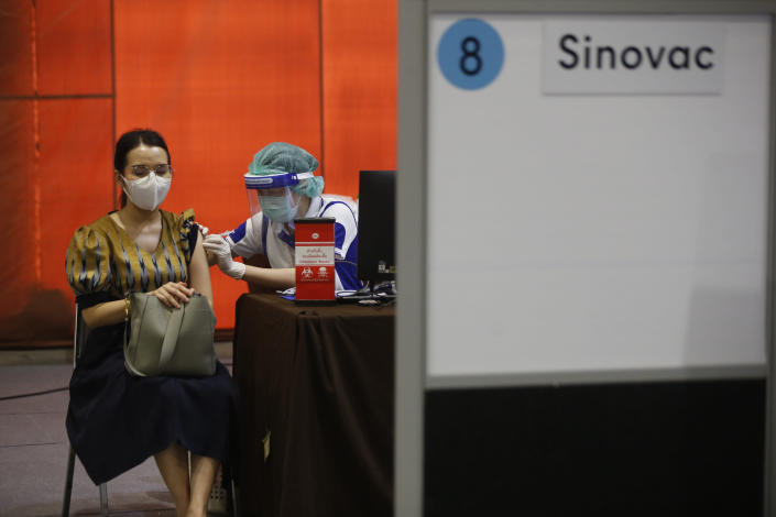 A health worker administers a dose of the Sinovac COVID-19 vaccine to a woman in Bangkok, Thailand, Monday, May 17, 2021. Health authorities in Thailand on Monday reported 9,635 new confirmed cases of COVID-19, a new daily high that brought the cumulative total since January last year to 111,082. Almost three-quarters of all cases were recorded since April 1, when Thailand's third coronavirus wave began. (AP Photo/Anuthep Cheysakron)