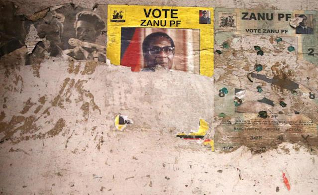 <p>An election poster from the 2008 ZANU-PF election campaign on the wall of a dilapidated building in the Mbara suburb of Harare, Nov. 17, 2017. (Photo: AP) </p>