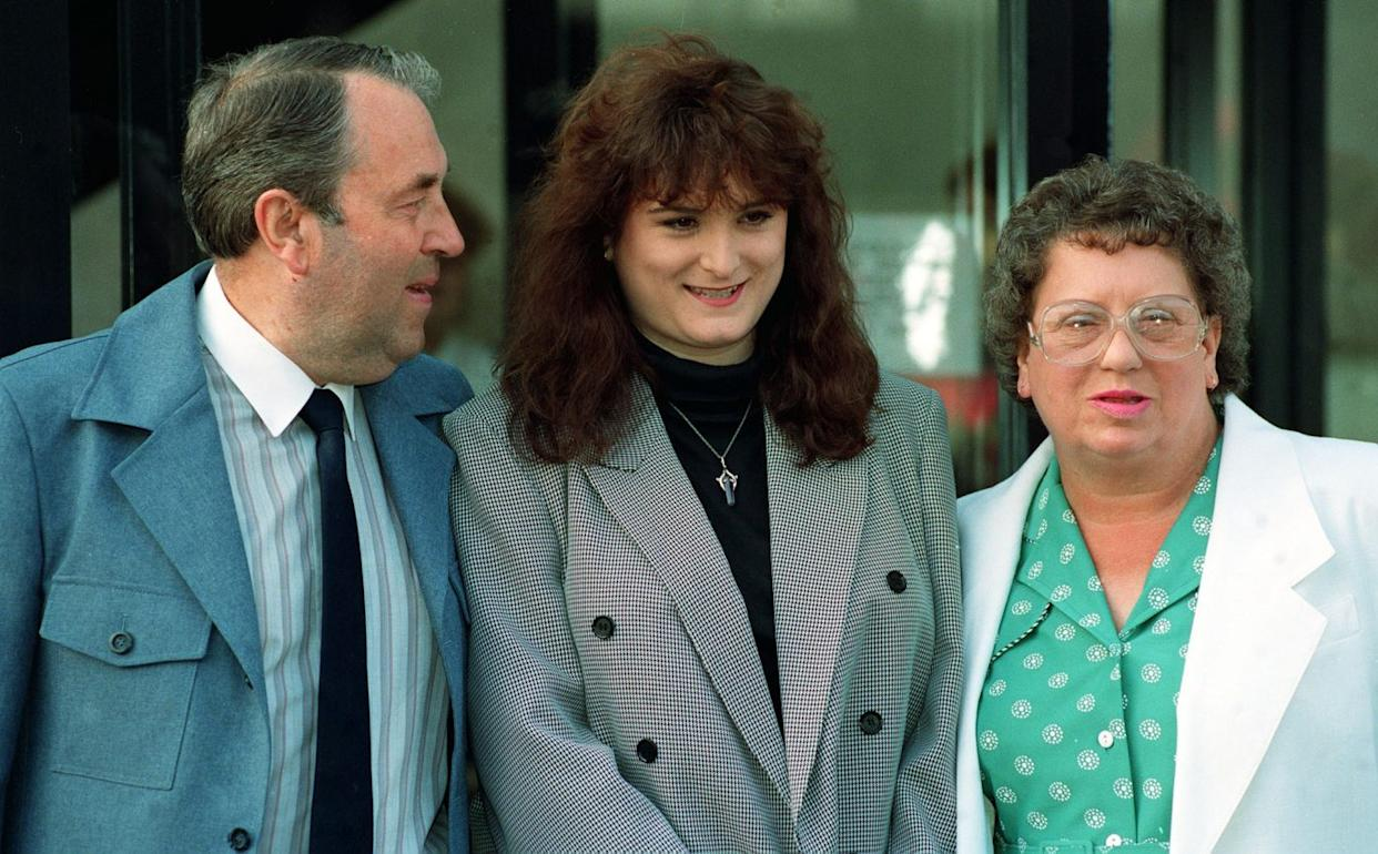 Stephanie Slater flanked by her parents Warren and Betty  (David Jones/PA)