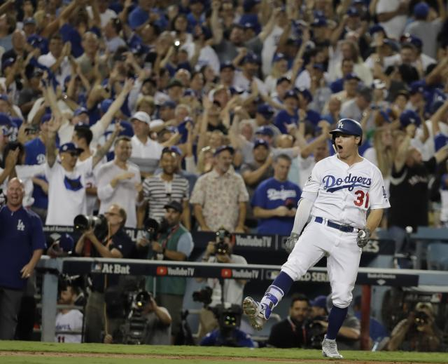 <p>Los Angeles Dodgers' Joc Pederson reacts after hitting a home run during the fifth inning of Game 2 of baseball's World Series against the Houston Astros Wednesday, Oct. 25, 2017, in Los Angeles. (AP Photo/David J. Phillip) </p>