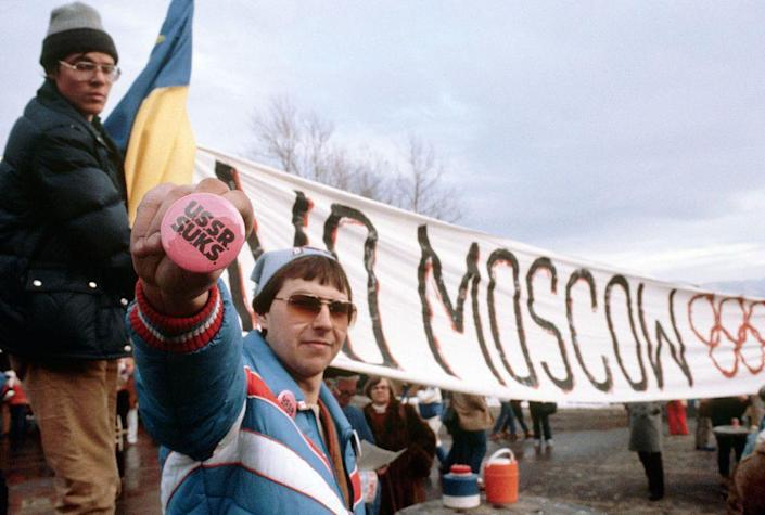 <p>During the peak of the Cold War, protestors flock to the opening ceremony of the Winter Olympics in Lake Placid in 1980. Many of them are fighting against the Summer Olympics being held in Moscow after the country's invasion of Afghanistan. </p>