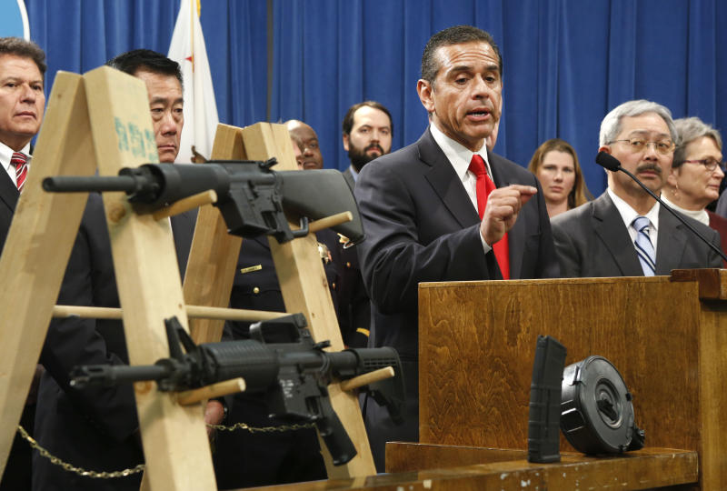 Los Angeles Mayor Antonio Villaraigosa, left, discusses his support for a package of proposed gun control legislation at a Capitol news conference in Sacramento, Calif., Thursday, Feb. 7, 2013. Senate Democrats unveiled a package of 10 proposed laws designed to close loopholes in existing gun regulations, keep firearms and ammunition out of the hands of dangerous person and strengthen education relating to firearms and gun ownership. Also seen are Sen. Marty Block, D-San Diego, left, Sen. Leland Yee, D-San Francisco, second from left, San Francisco Mayor Ed Lee, second from right and Sen. Loni Hancock, D-Berkeley, right. (AP Photo/Rich Pedroncelli)
