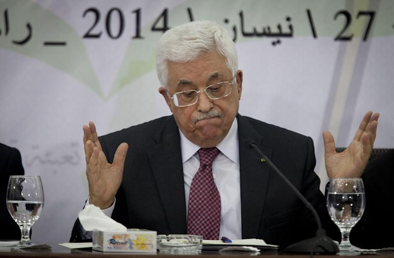 """FILE - Palestinian President Mahmoud Abbas speaks during a meeting with the Palestinian Central Council, a top decision-making body, at his headquarters in the West Bank city of Ramallah, in this April 26, 2014 file photo. Abbas has called the Holocaust """"the ugliest crime humanity has known in modern history."""" His comments, published Sunday April 27, 2014 by the Palestinian official news agency WAFA, marked a, rare acknowledgment by an Arab leader of Jewish suffering during the Nazi genocide. (AP Photo/Majdi Mohammed, File)"""