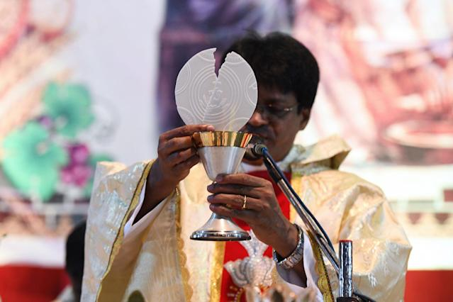 <p>Indian Catholic Priest Father Jaya Raj celebrates mass during a Maundy Thursday service at the St. Alphonsus Church in Hyderabad on March 29, 2018. The ceremony commemorates the symbolic cleansing by Jesus Christ of his apostles at the last supper on the eve of his crucifixion. (Photo: Noah Seelam/AFP/Getty Images) </p>