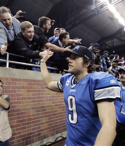 Detroit Lions quarterback Matthew Stafford (9) celebrates with fans after the Lions defeated the San Diego Chargers 38-10 in an NFL football game to clinch a playoff spot on Saturday, Dec. 24, 2011, in Detroit. (AP Photo/Duane Burleson)