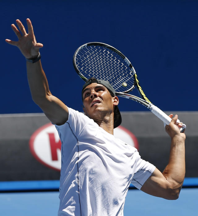 Rafael Nadal of Spain practices during a training session, one day before his men's singles final against Stanislas Wawrinka of Switzerland at the Australian Open tennis championship in Melbourne, Australia, Saturday, Jan. 25, 2014. (AP Photo/Shuji Kajiyama)