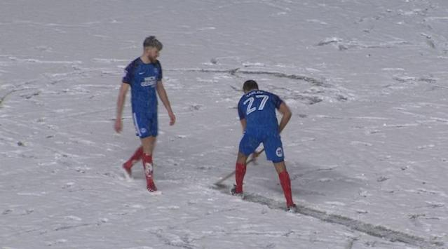 Peterboroughs League One match against Walsall came up against some harsh conditions so Taylor and team-mate Junior Morias mucked in to salvage their win