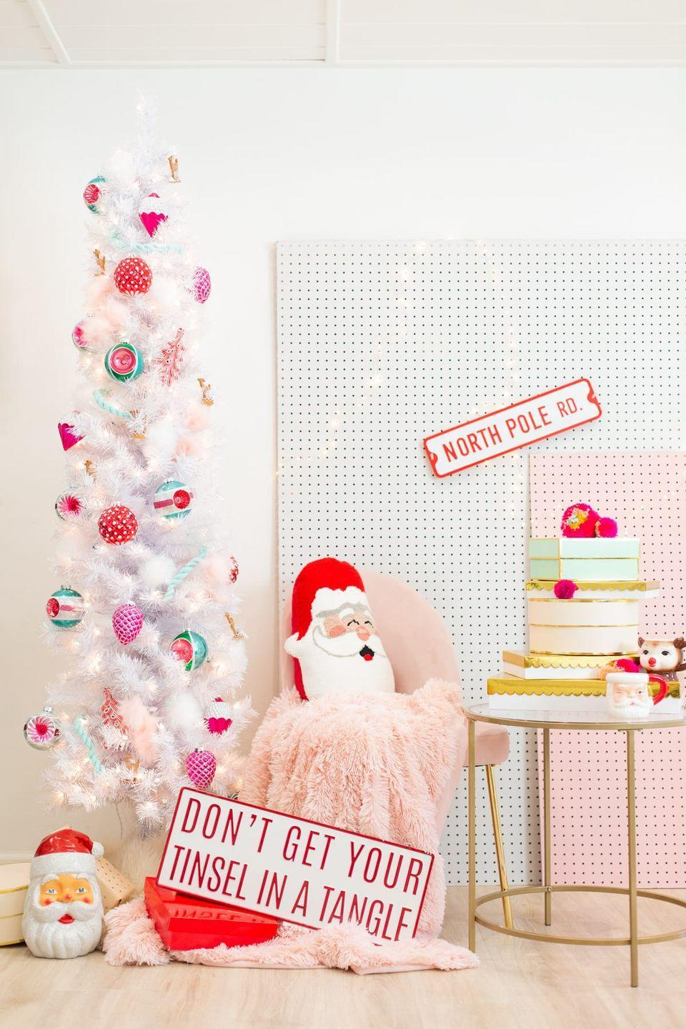"""<p>Even big baubles deserve a spot on this slim tree. Add color (and cheer!) to this otherwise neutral display with red, pink, and teal ornaments.</p><p><em><a href=""""https://lovelyindeed.com/hey-holidays-a-pink-red-and-green-christmas-tree/"""" rel=""""nofollow noopener"""" target=""""_blank"""" data-ylk=""""slk:Get the tutorial at Lovely Indeed »"""" class=""""link rapid-noclick-resp"""">Get the tutorial at Lovely Indeed »</a></em></p>"""