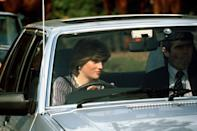 <p>Diana Spencer behind the wheel of her Ford Escort car along with her bodyguard.</p>