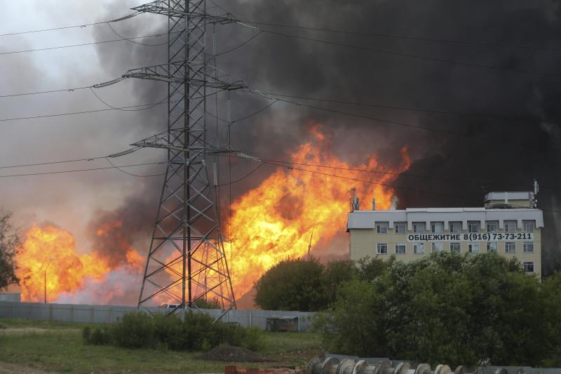 Black smoke and flames rise over a power station, in Mytishchi, outside Moscow, Russia, Thursday, July 11, 2019. The fire broke out on Thursday on the premises of a power station just outside Moscow, injuring five people. (Sergey Vedyashkin, Moscow News Agency photo via AP)