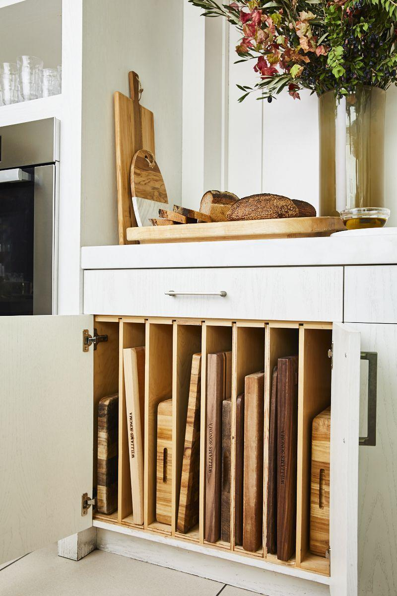 "<p>This <a href=""https://www.housebeautiful.com/lifestyle/organizing-tips/g3426/best-kitchen-organization-tips/"" rel=""nofollow noopener"" target=""_blank"" data-ylk=""slk:filing organizer"" class=""link rapid-noclick-resp"">filing organizer</a> <em>(similar for $15, <a href=""https://www.westelm.com/products/plate-cutting-board-stand-d7923/?catalogId=71&sku=4350545&cm_ven=PLA&cm_cat=Google&cm_pla=Kitchen%20%2B%20Dining%20%3E%20Organization%20%2B%20Food%20Storage&cm_ite=4350545&gclid=Cj0KCQjwsqmEBhDiARIsANV8H3Z5IHhn5FjalZc3OtufX8ojVNV65uPWMN80F4Wzg-GVTT-xQ0gtd8saAvlaEALw_wcB"" rel=""nofollow noopener"" target=""_blank"" data-ylk=""slk:westelm.com"" class=""link rapid-noclick-resp"">westelm.com</a></em>) is ideal for heavy serving platters, cutting boards, and trays because it screws into the bottom of the cabinet and won't wiggle as you pull items in and out.</p>"