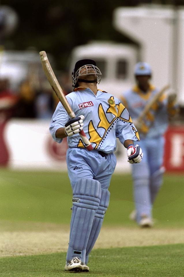 23 May 1999:  Sachin Tendulkar of India reaches his century during the Cricket World Cup Group A match against Kenya played in Bristol, England. India won the game by 94 runs. \ Mandatory Credit: Craig Prentis /Allsport