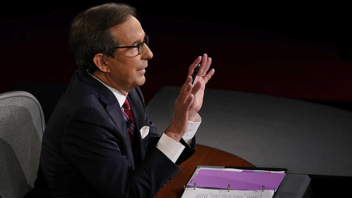 Moderator Chris Wallace of Fox News gestures toward President Trump and Democratic presidential candidate former Vice President Joe Biden during the first 2020 presidential debate. (Morry Gash, Pool via AP)