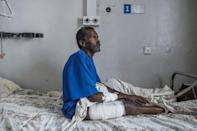 Tamrat Kidanu said he lay motionless after being shot as he heard Eritrean troops massacring his son and other men in Dengolat