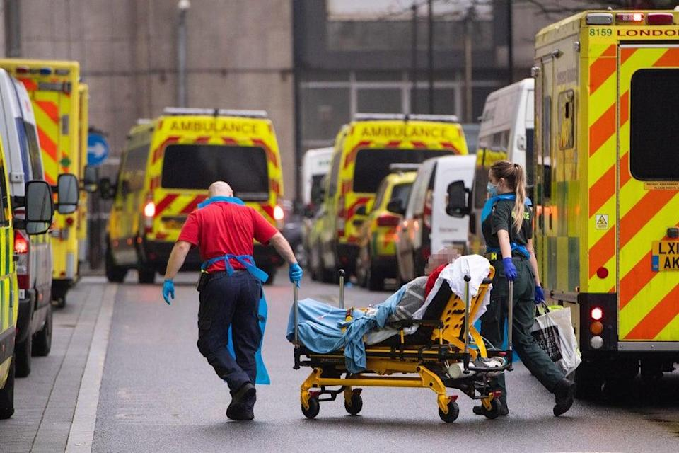 Paramedics unload a patient from an ambulance outside the Royal London Hospital in London (PA)