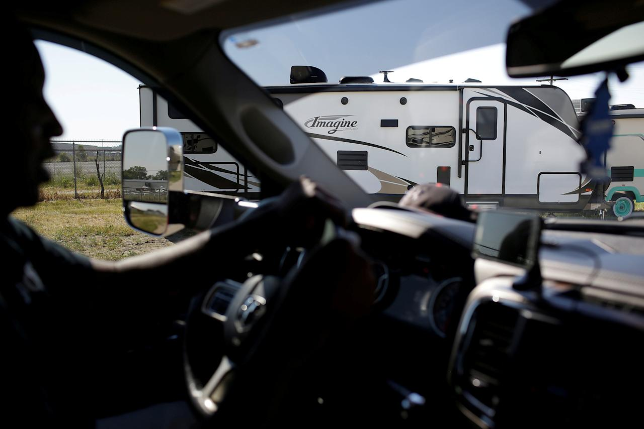 FILE PHOTO: Tracy DeGraffreed a recreational vehicle delivery driver for Skypoint Transit drives through a RV parking lot in Goshen, Indiana, U.S. on June 12, 2017.    REUTERS/Joshua Lott/File Photo