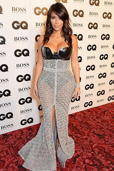 GQ's Woman of the Year Kim Kardashian made her mark on the red carpet in a bondage-inspired custom dress by Ralph & Russo Couture, featuring a latex bodysuit and a sheer metallic skirt.