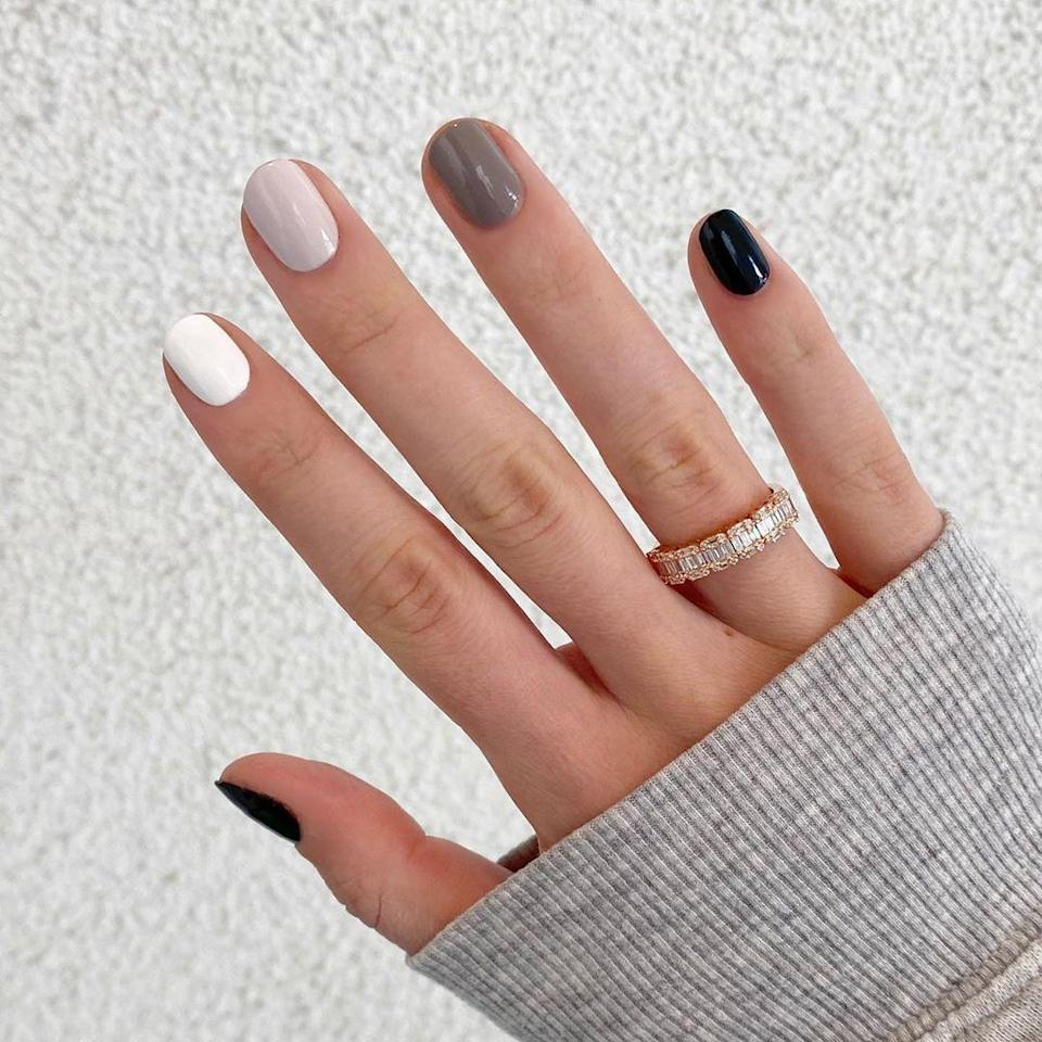 "Neutral doesn't have to mean boring. Mix things up with a scattered mani in gray tones. <a href=""https://oliveandjune.com/collections/mani-sets/products/five-shades-of-grey"" rel=""nofollow noopener"" target=""_blank"" data-ylk=""slk:Olive & June's 5 Shades of Gray kit"" class=""link rapid-noclick-resp"">Olive & June's 5 Shades of Gray kit</a> gives you all the polishes you need in one place."