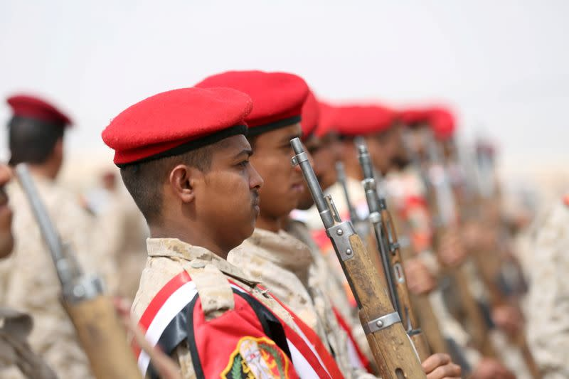 FILE PHOTO: Military police troops stand at attention during the funeral of Brigadier General Ahmad Saleh al-Uqaily in Marib, Yemen