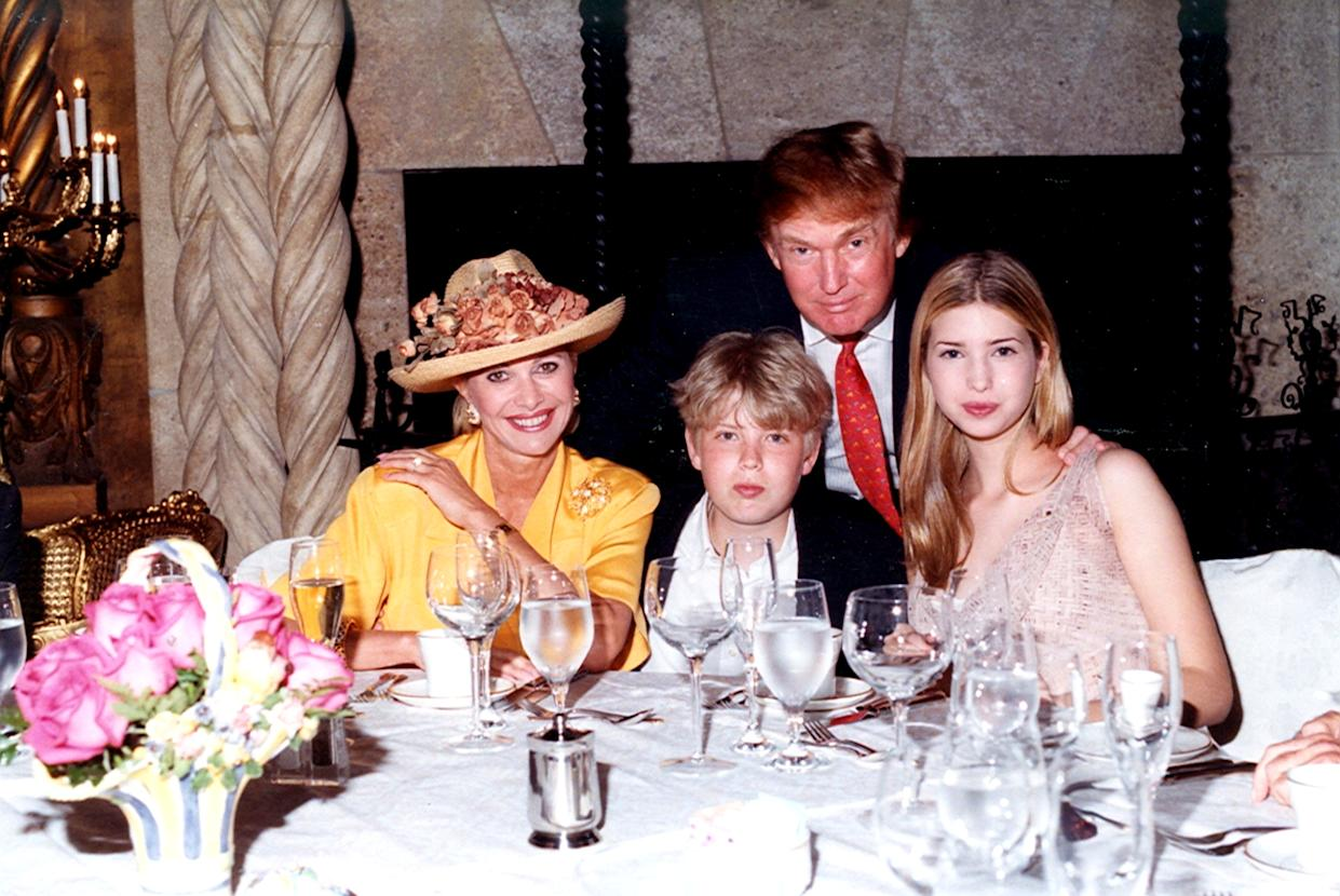 Family portrait of, from left, socialite Ivana Trump, her son Eric Trump, her former husband businessman Donald Trump, and her daughter Ivanka Trump as they sit at a table at the Mar-a-Lago estate, Palm Beach, Florida, 1998. (Photo by Davidoff Studios/Getty Images)