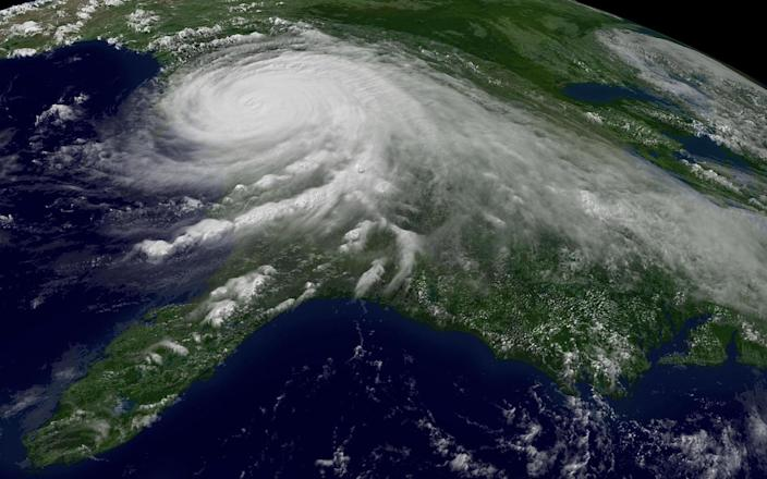 FILE - This Aug. 29, 2005 file photo provided by NOAA shows a satellite image of Hurricane Katrina. U.N. climate experts say global warming accelerated since the 1970s, breaking more countries' temperature records than ever before. The World Meteorological Organization's analysis Wednesday, July 3, 2013 calls the first decade of the new millennium an unprecedented era of climate extremes ranging from heat waves in Europe and Russia, to droughts in the Amazon Basin, Australia and East Africa, to huge storms like Tropical Cyclone Nargis and Hurricane Katrina. (AP Photo/NOAA, File)