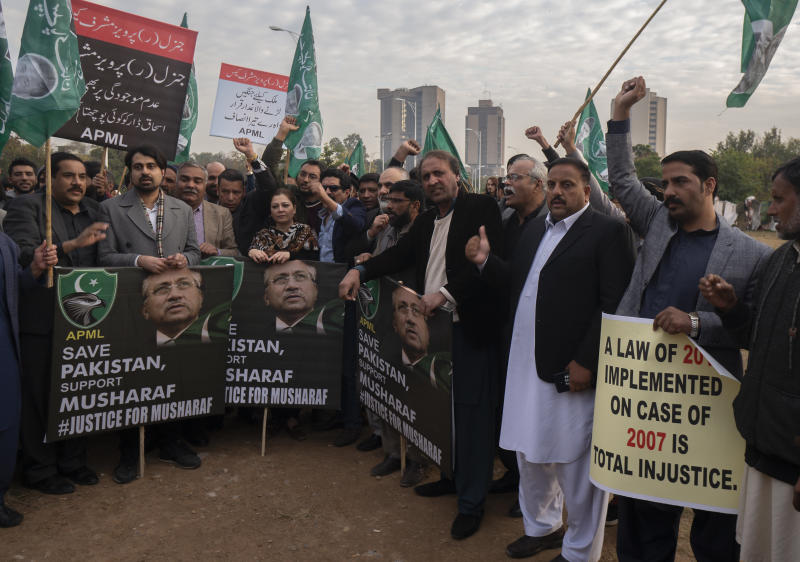 Supporters of former Pakistani military ruler Gen. Pervez Musharraf protest a court's decision, in Islamabad, Pakistan, Wednesday, Dec. 18, 2019. The Pakistani court sentenced Musharraf to death in a treason case related to the state of emergency he imposed in 2007 while in power, officials said. Musharraf who is apparently sick and receiving treatment in Dubai where he lives was not present in the courtroom. (AP Photo/B.K. Bangash)