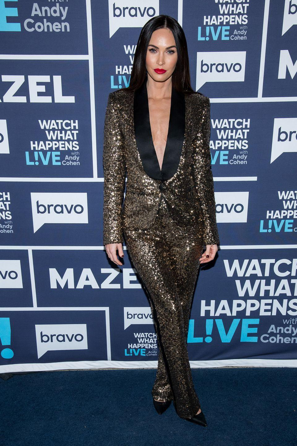 <p>The actor wore a festive gold tux and black pointed-toe heels, with a bright red lip and straight black hair for the TV show appearance. </p>