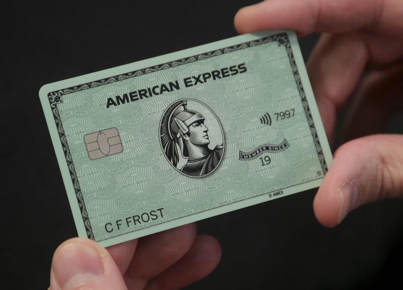"In this Wednesday, Oct. 23, 2019, photo Ira Galtman, American Express director of corporate archives, shows the new American Express ""Green Card,"" in New York. For 50 years, ""Green Card"" was everywhere and now it's getting a much-needed revamp, with a new look and more travel benefits. (AP Photo/Bebeto Matthews)"