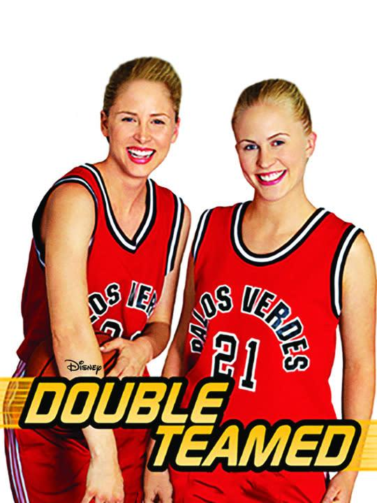 """<p>Despite its highly suggestive and frankly inappropriate title, <i>Double Teamed</i> is actually about a pair of athletic sisters who become internationally renowned """"basketball players.""""<br><br><i>(Credit: Disney Channel)</i> </p>"""