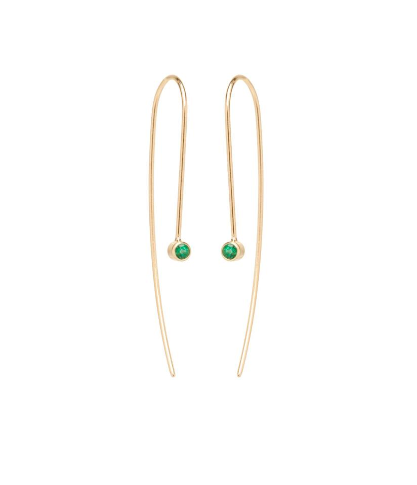 """<p>Emerald wire earrings in 14-karat yellow gold with 2.5mm emeralds, $395, <a rel=""""nofollow"""" href=""""https://zoechicco.com/products/14k-emerald-wire-earrings"""">zoechicco.com</a> </p>"""