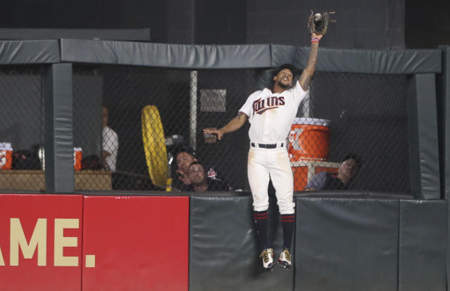 Minnesota Twins center fielder Byron Buxton (25) catches a fly ball by Cleveland Indians designated hitter Edwin Encarnacion (10) during the seventh inning Aug. 15, 2017, in Minneapolis. (AP)