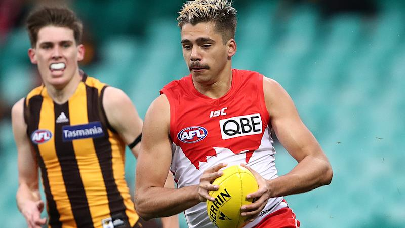 Elijah Taylor, pictured here in action for Sydney Swans against Hawthorn in the AFL.