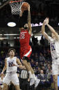 Nebraska guard Haanif Cheatham, center, drives to the basket against Northwestern forward Pete Nance, left, forward Robbie Beran during the first half of an NCAA college basketball game in Evanston, Ill., Saturday, Jan. 11, 2020. (AP Photo/Nam Y. Huh)