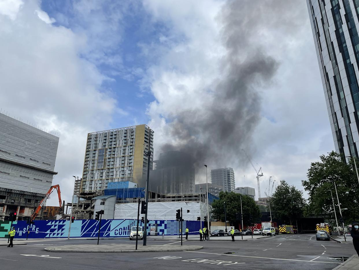 Emergency services at the scene of a fire that has broken out at garages close to Elephant and Castle railway station in London. Issue date: Monday June 28, 2021.