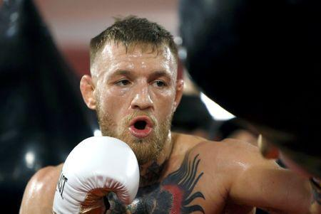 Conor McGregor of Ireland hits a heavy bag during a workout at the UFC Performance Center in Las Vegas, Nevada, U.S., August 11, 2017. REUTERS/Steve Marcus