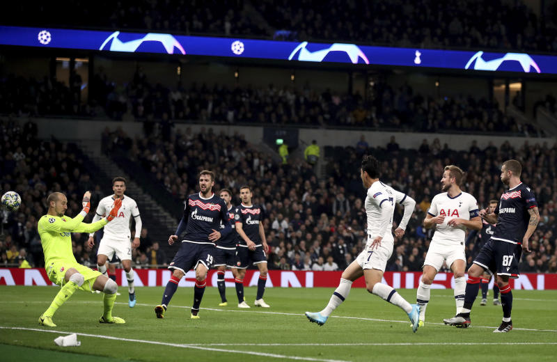 Tottenham Hotspur's Son Heung-min, center, scores his side's second goal of the game during the Champions League Group B match against Red Star at Tottenham Hotspur Stadium, London, Tuesday Oct. 22, 2019. (Nick Potts/PA via AP)