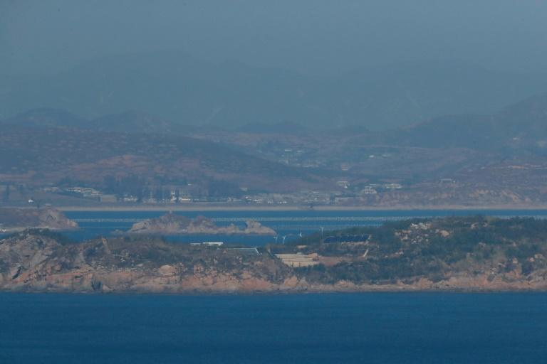 North Korea seen from South Korea's western island of Yeonpyeong, near where Seoul says one of its fisheries officials was shot dead
