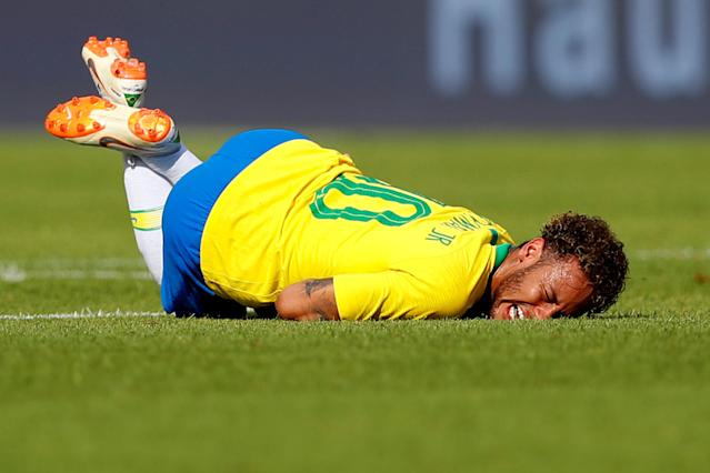 Soccer Football - International Friendly - Austria vs Brazil - Ernst-Happel-Stadion, Vienna, Austria - June 10, 2018 Brazil's Neymar lies injured REUTERS/Leonhard Foeger