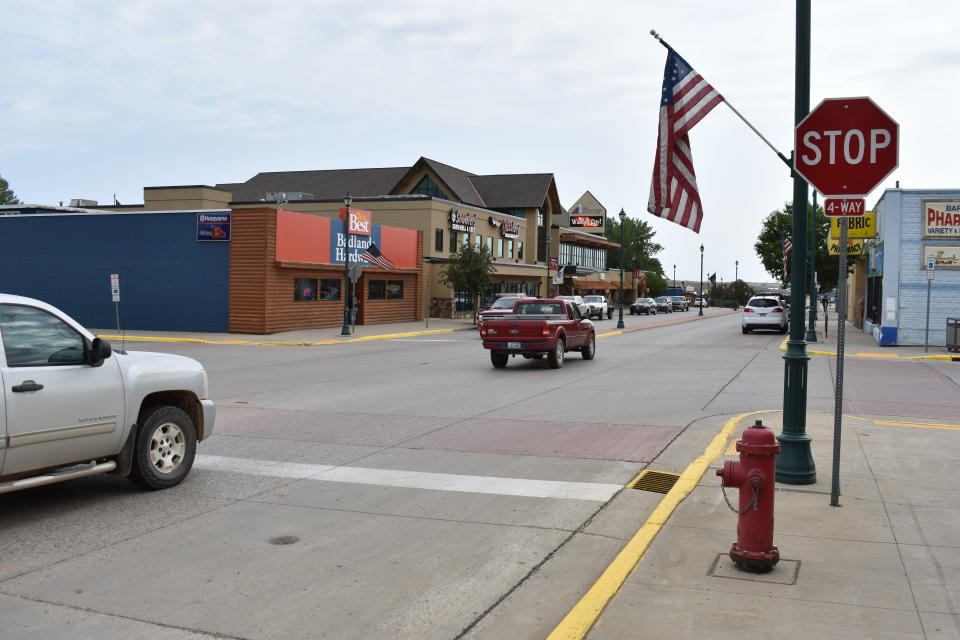 Cars move down Main Street in Watford City, N.D., Aug. 25, 2021, part of McKenzie County. A drilling boom made McKenzie the fastest growing county in the U.S over the past decade, according to the 2020 census. (AP Photo/Matthew Brown)