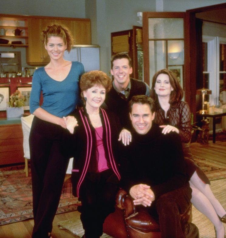 Reynolds with Debra Messing, Sean Hayes and Megan Mullally on the set of Will and Grace. Photo: Getty Images