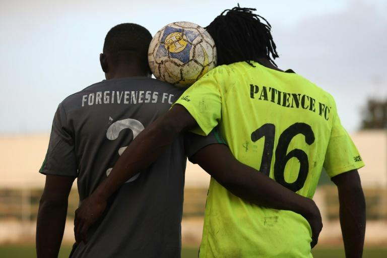 The captains of Forgiveness FC and Patience FC, posing for a photo after a final in Jos