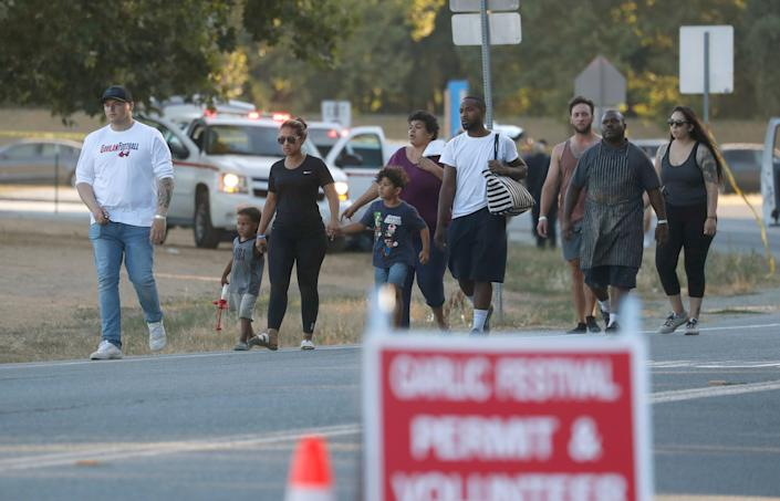People leave the Gilroy Garlic Festival following a deadly shooting in Gilroy, Calif., on Sunday, July 28, 2019.