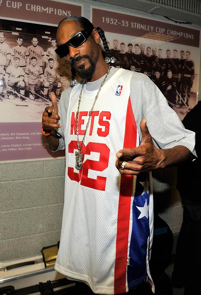 """Even rapper Snoop Dogg has Bieber Fever! Kevin Mazur/<a href=""""http://www.wireimage.com"""" target=""""new"""">WireImage.com</a> - August 1, 2010"""