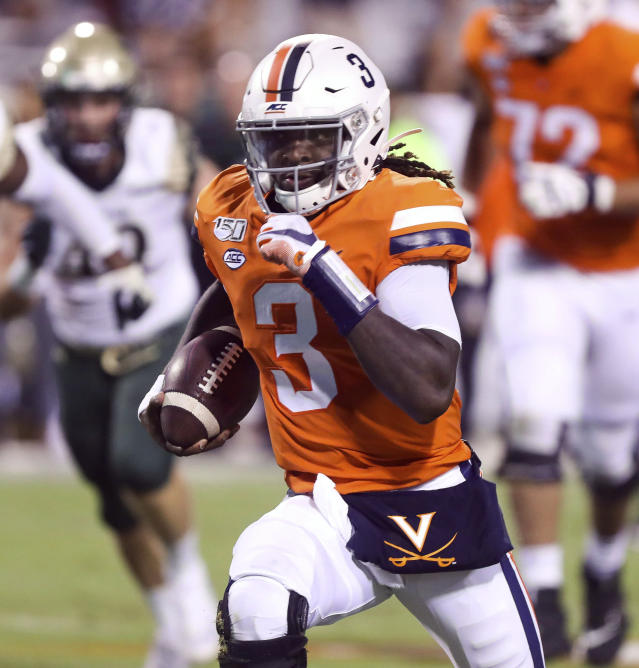 Virginia quarterback Bryce Perkins (3) runs in front of William & Mary defenders during the first half of an NCAA college football game in Charlottesville, Va., Friday, Sept. 6, 2019. (AP Photo/Andrew Shurtleff)