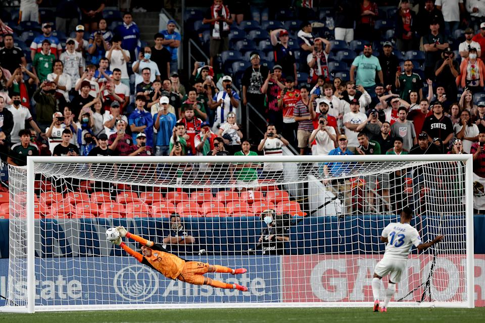 DENVER, COLORADO - JUNE 03: Goalie Guillermo Ochoa #13 of Mexico saves a shot goal by Allan Cruz #13 of Costa Rica to win on penalty kicks during Game 2 of the Semifinals of the CONCACAF Nations League Finals of at Empower Field At Mile High on June 03, 2021 in Denver, Colorado. (Photo by Matthew Stockman/Getty Images)