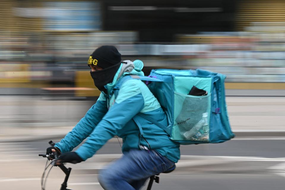 A Deliveroo rider cycles through central London. Photo: Daniel Leal-Olivas/AFP via Getty Images