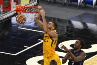 Utah Jazz center Rudy Gobert (27) scores in front of Orlando Magic forward Al-Farouq Aminu (2) in the first quarter during an NBA basketball game, Saturday Feb. 27, 2021, in Orlando, Fla. (AP Photo/Joe Skipper)